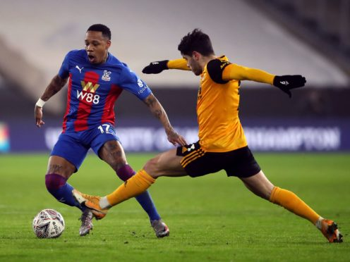 Nathaniel Clyne, left, helped Crystal Palace claim a 1-0 win over Wolves (Nick Potts/PA)