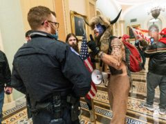 Supporters of President Donald Trump are confronted by US Capitol Police officers outside the Senate Chamber inside the Capitol in Washington (Manuel Balce Ceneta/AP)
