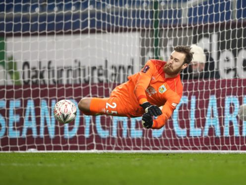 Will Norris saves from Lasse Sorensen in the penalty shoot-out (Tim Goode/PA)