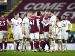 Burnley and MK Dons players shake hands following the Clarets' shoot-out victory (Tim Goode/PA)