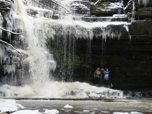 A frozen Summerhill Force waterfall at Bowlees in Teesdale (Owen Humphreys/PA)