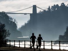 Joggers exercising along the River Avon in Bristol (David Davies/PA)
