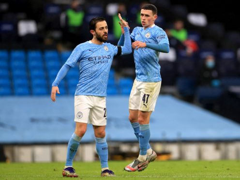 Phil Foden (right) and Bernardo Silva were on target for City (Mike Egerton/PA)