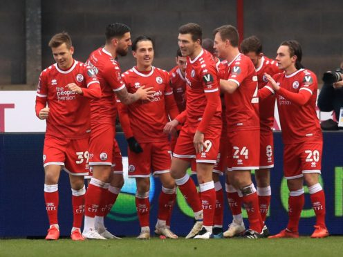 Crawley Town celebrate their second goal by Ashley Nadesan (hidden) in a shock 3-0 FA Cup third round win over Premier League Leeds (Adam Davy/PA Images).