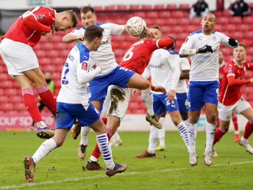Barnsley's Michal Helik (left) heads home his side's opener in a 2-0 FA Cup third round win over Tranmere (Zac Goodwin/PA Images).