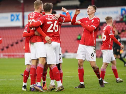 Barnsley's Michal Helik (left) celebrates with his team-mates after scoring his side's opener in a 2-0 FA Cup third round win over Tranmere (Zac Goodwin/PA Images).