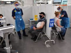 Ministers want every adult in the UK to have been offered a coronavirus jab by September (Jacob King/PA)