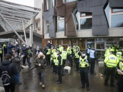 Police faced off with protesters outside Holyrood (Jane Barlow/PA)