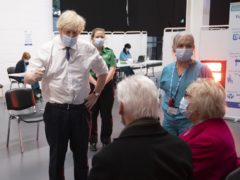 Prime Minister Boris Johnson speaking to Hazel and John Watson (Eddie Mulholland/The Daily Telegraph/PA)