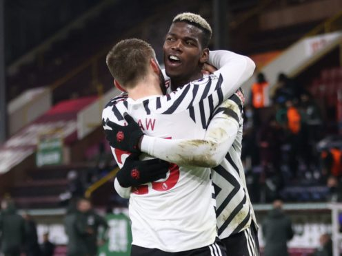 Paul Pogba, right, made the breakthrough at Turf Moor with a deflected volley (Clive Brunskill/PA)