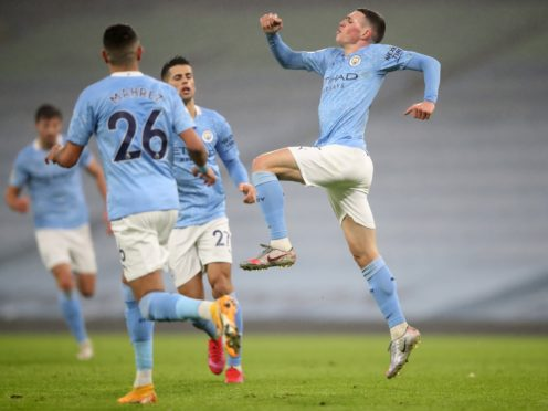 Phil Foden fired Manchester City to victory over Brighton (Clive Brunskill/PA)