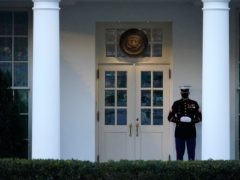 A Marine guard stands at the entrance to the West Wing of the White House (Gerald Herbert/AP)