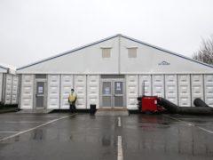 Security staff at the overflow mortuary at Breakspear Crematorium in Ruislip, London (Jonathan Brady/PA)