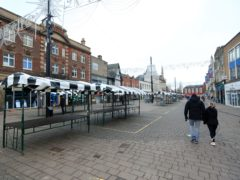 A quiet high street in Loughborough, Leicestershire during England's third national lockdown to curb the spread of coronavirus. Households believe it will take three years on average for their finances to fully recover from the impact of the coronavirus pandemic, according to comparethemarket.com (Mike Egerton/PA)