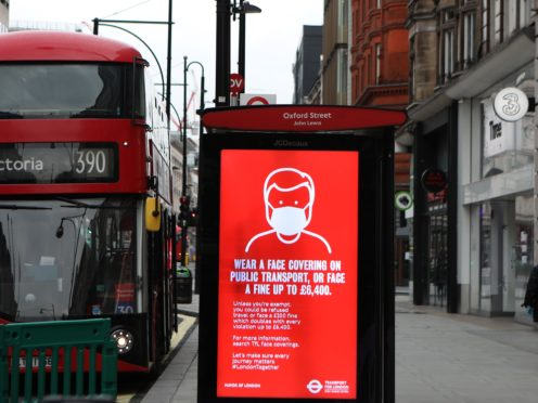 A bus advert advising the wearing of face coverings in Oxford Street, London (Luciana Guerra/PA)