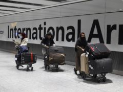British travellers rushed to return home from the United Arab Emirates ahead of a flight ban (Kirsty O'Connor/PA)