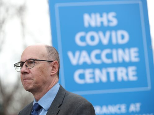 Stephen Powis outside the NHS Covid Vaccine Centre in Wembley, north London (Yui Mok/PA)