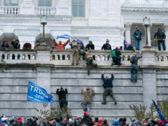 Supporters of President Donald Trump climbed the west wall of the the US Capitol (Jose Luis Magana/AP)