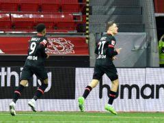 Florian Wirtz celebrates scoring the winner for Bayer Leverkusen (Martin Meissner/AP)