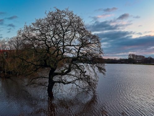 Parrs Wood High School playing fields were flooded after the River Mersey rose high in Didsbury (Peter Byrne/PA)