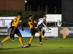 Chorley's Elliot Newby has a shot on goal in the defeat to Wolves (Martin Rickett/PA).