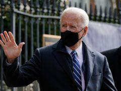 President Joe Biden waves as he departs after attending Mass at Holy Trinity Catholic Church (Patrick Semansky/AP)