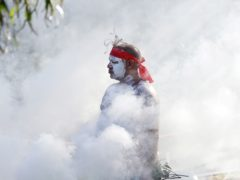 Russell Dawson of the Koomurri Aboriginal Dancers participates in a smoking ceremony during Australia Day ceremonies in Sydney (Rick Rycroft/AP)
