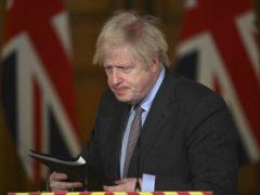 Prime Minister Boris Johnson leaves the podium following a media briefing in Downing Street on coronavirus (Justin Tallis/PA)