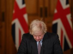 Almost a year on from the first known Covid-19 death on January 30 2020, Prime Minister Boris Johnson said he was 'deeply sorry' to announce that the number of UK deaths had passed 100,000 (Justin Tallis/PA)