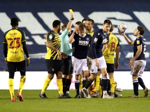 Referee Jeremy Simpson shows Millwall's Maikel Kieftenbeld a yellow card (Aaron Chown/PA)