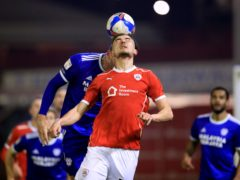 Cardiff's Kieffer Moore and Barnsley's Michal Helik battle for the ball (Mike Egerton/PA)