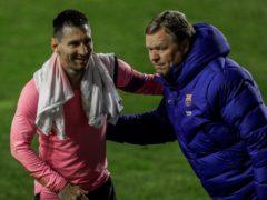 Lionel Messi celebrates with Ronald Koeman after Barcelona's win (Manu Fernandez/AP