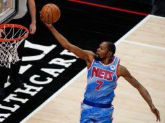 Brooklyn Nets forward Kevin Durant scores against the Atlanta Hawks (Brynn Anderson/AP)