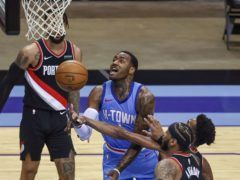 Houston Rockets guard John Wall shoots during the third quarter against the Portland Trail Blazers (Troy Taormina/Pool Photo via AP)