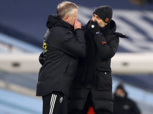 Pep Guardiola (right) is baffled Sheffield United are in the position they are (Martin Rickett/PA)