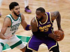 Boston Celtics' Jayson Tatum defends against Los Angeles Lakers' LeBron James (Michael Dwyer/AP)
