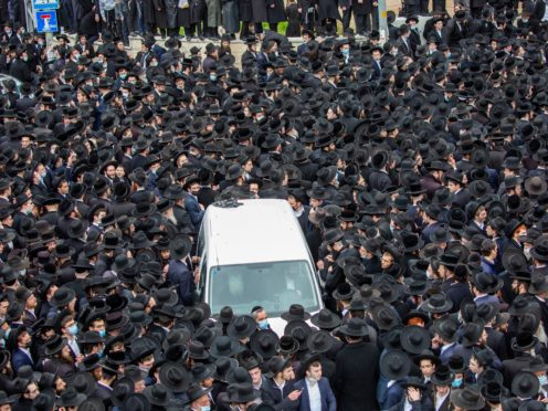 Thousands of ultra-Orthodox Jews join the funeral procession for Rabbi Meshulam Soloveitchik in Jerusalem (Ariel Schalit/AP)