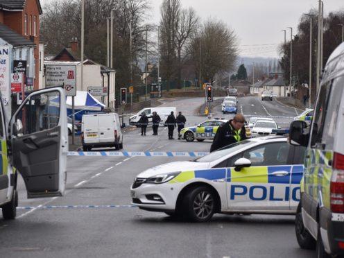 Police at the scene in Queens Cross in Dudley (Matthew Cooper/PA)