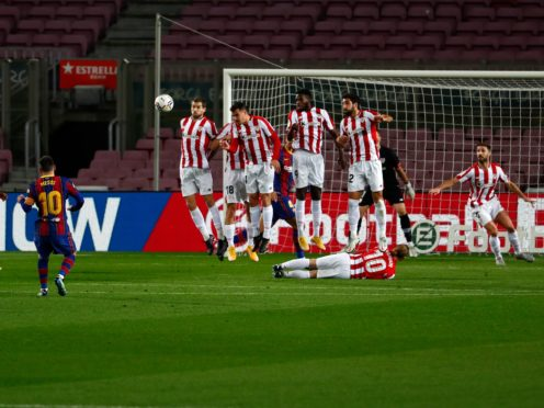 Lionel Messi opens the scoring with a free-kick in Barcelona's win over Athletic Bilbao (Joan Monfort/AP).