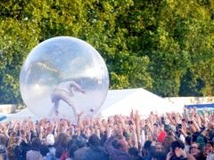 Wayne Coyne of The Flaming Lips performs inside of a giant plastic ball at Lovebox festival, east London in 2008 (Zak Hussein/PA)