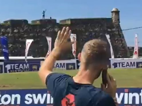 Joe Root shares a phone call with England fan Rob Lewis, who waited 10 months in Sri Lanka for the team to arrive (ECB/@englandcricket)