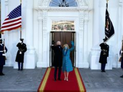 President Joe Biden and first lady Jill Biden wave as they arrive at the North Portico of the White House (Alex Brandon, Pool)
