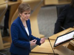 Nicola Sturgeon said Scotland would match a scheme to pay everyone confirmed with Covid-19 £500 – if it is introduced south of the border (Jane Barlow/PA)