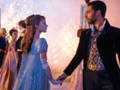 Sparks fly between Daphne, played by Phoebe Dynevor, and the rebellious Duke of Hastings, played by Rege-Jean Page ((Liam Daniel/Netflix/PA)
