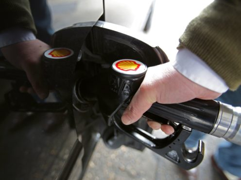 A customer filling up his car at a Shell petroll station in London, as the board of BG Group has backed a takeover offer worth about £47 billion from Royal Dutch Shell.