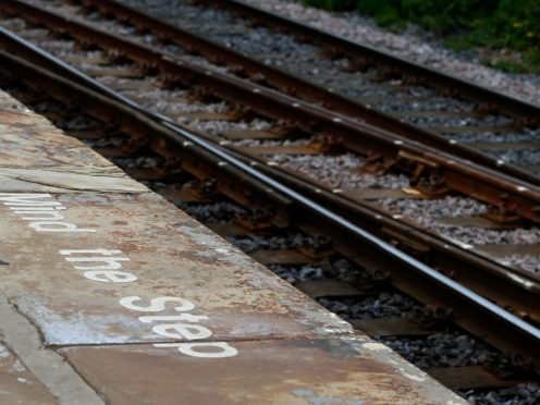 Tactile strips should be installed near the edge of 'high-risk' railway station platforms, an investigation into the death of a visually impaired man has found (Lynne Cameron/PA)