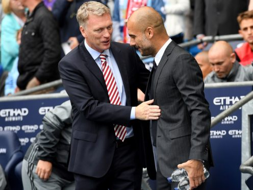 Pep Guardiola (right) comes up against David Moyes (left) this weekend (Anthony Devlin/PA)