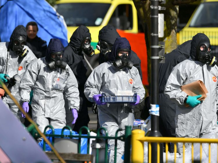 Police in protective suits in Salisbury following the poisoning of former Russian spy Sergei Skripal and his daughter, Yulia (Ben Birchall/PA)