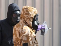 Investigators in chemical suits remove an item as they work behind screens erected in Rollestone Street, Salisbury after the poisoning. (Yui Mok/PA Wire)