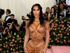 Kim Kardashian wished her late father a happy birthday as she returned to Instagram after filing for divorce from Kanye West (Jennifer Graylock/PA)